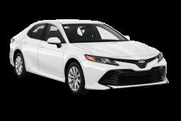 2020 toyota camry le auto sedan angular front 1 3